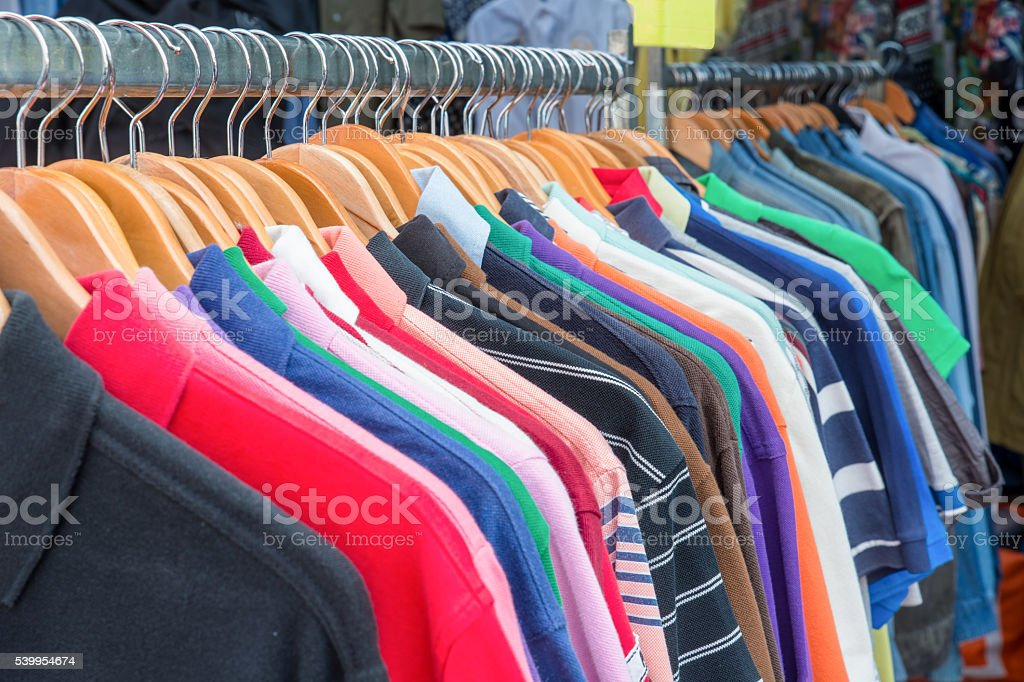 Front view of polo shirts on hanger. Colorful polo shirts. stock photo