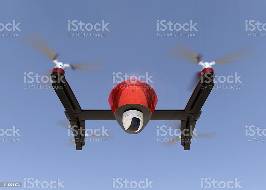Front view of red drone with camera in the sky stock photo
