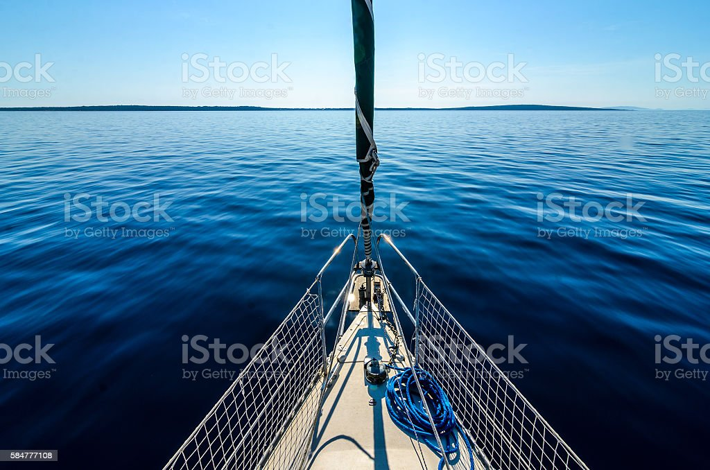 Front view of sailing boat on the sea. stock photo