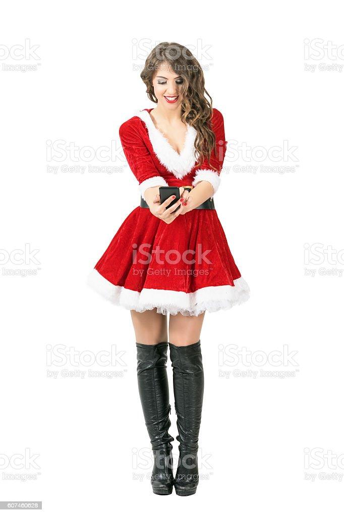 Front view of smiling beautiful Santa Woman taking selfie stock photo