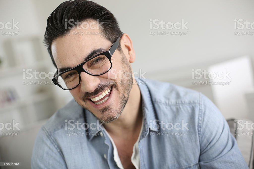 Front view of smiling man at home royalty-free stock photo