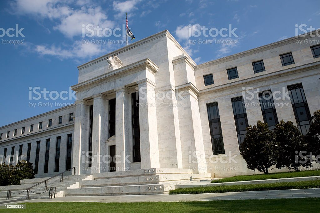 Front view of the US Federal Reserve with sky in distance stock photo