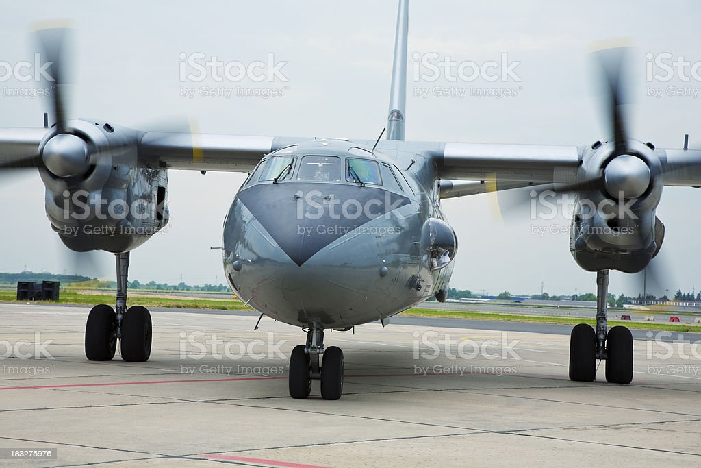 Front View of Twin Turboprop Cargo Plane Taxiing on Runway stock photo