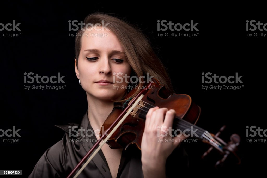 front view portrait of a violinist woman stock photo