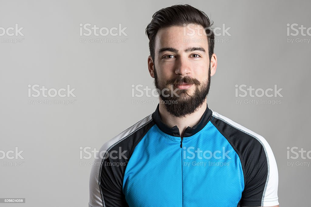 Front view portrait of happy cyclist wearing cycling jersey t-shirt stock photo