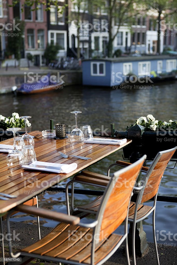 Front view sidewalk cafe along the Amsterdam Canal royalty-free stock photo