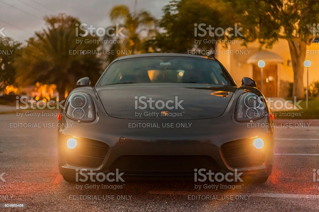 Front view with headlamps on of a Porsche Cayman stock photo