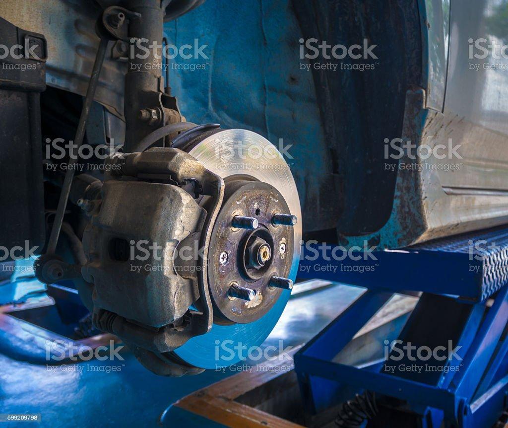 Front wheel disk brake and caliper maintenance job in progress. stock photo