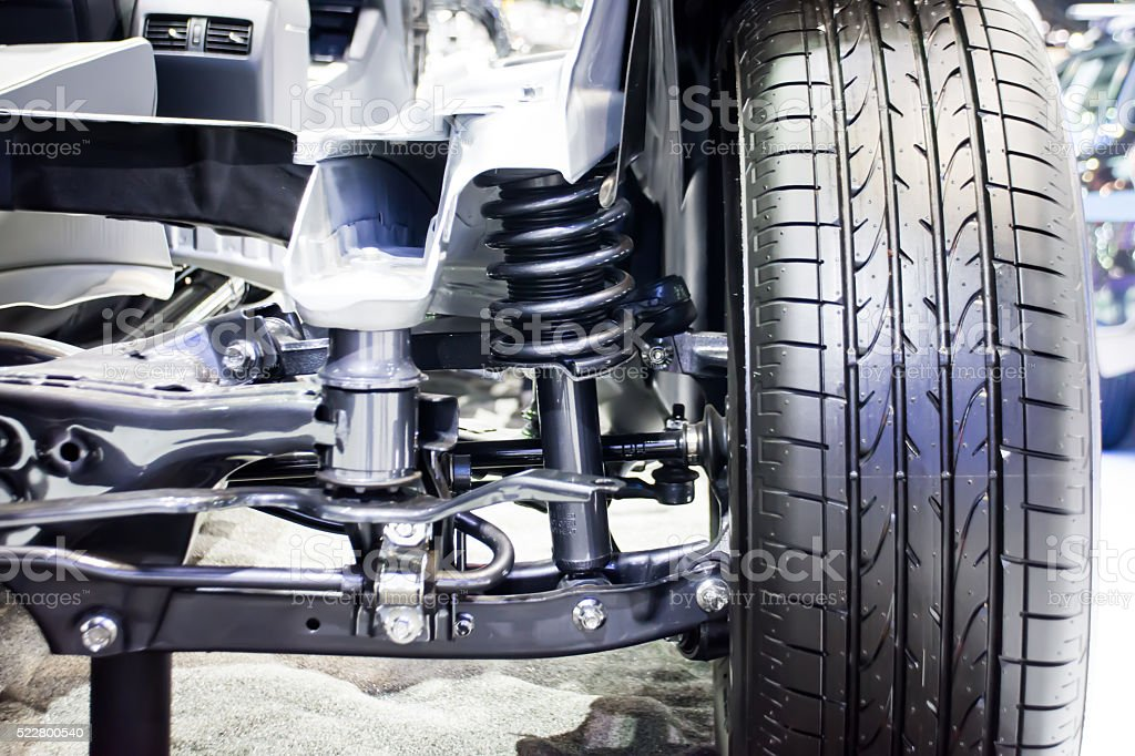 Front wheel of car with new tire and Shock Absorber stock photo