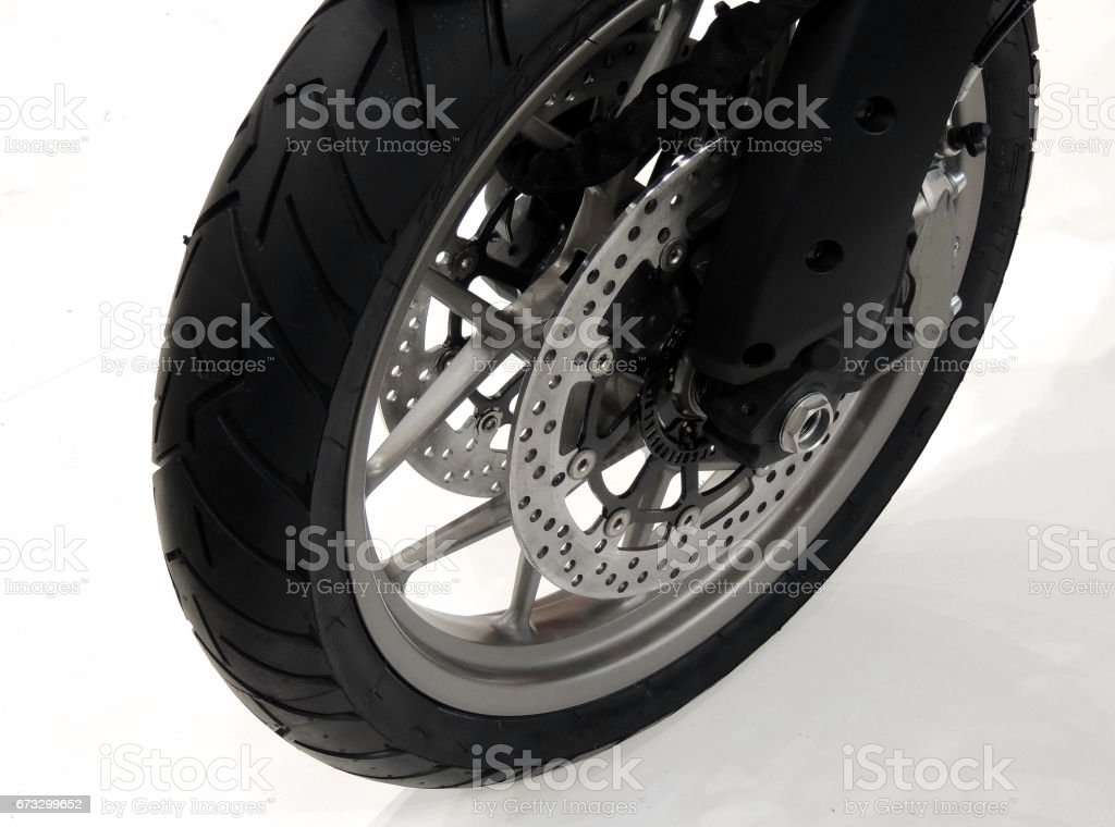 Front wheel of sport motorcycle on white background stock photo stock photo