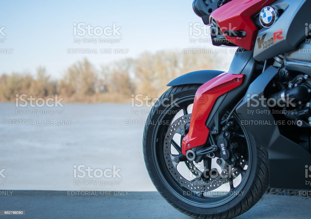 Front wheel of the BMW Motorcycle photographed outdoors stock photo