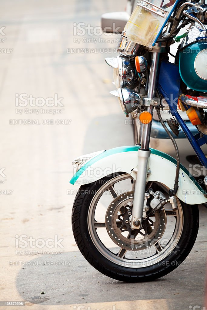 Front wheel with eagle of tuktuk in Udonthani stock photo