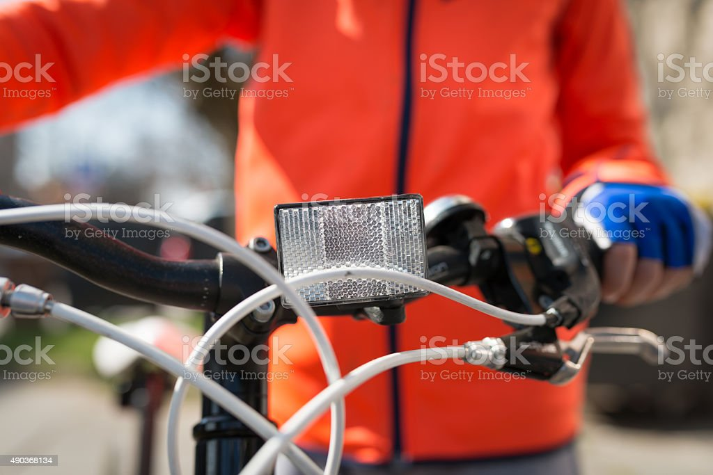 Front white reflector on bike stock photo