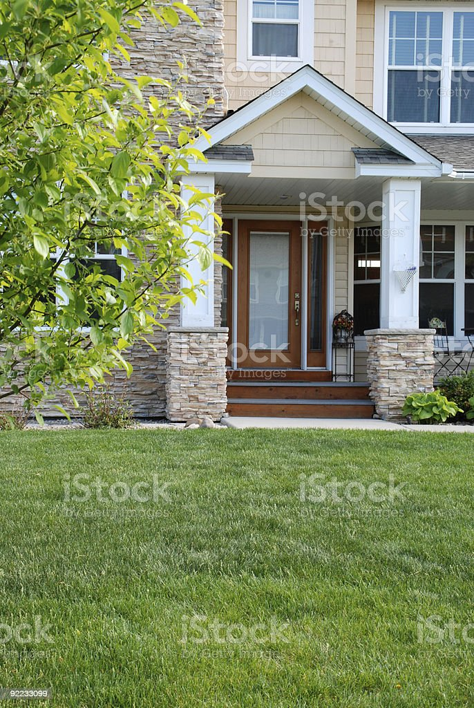 Front Yard and Doorway of Beautiful Home royalty-free stock photo