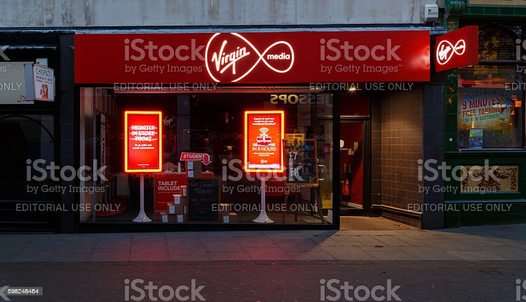 Frontage of the Virgin Media store at night, Nottingham stock photo