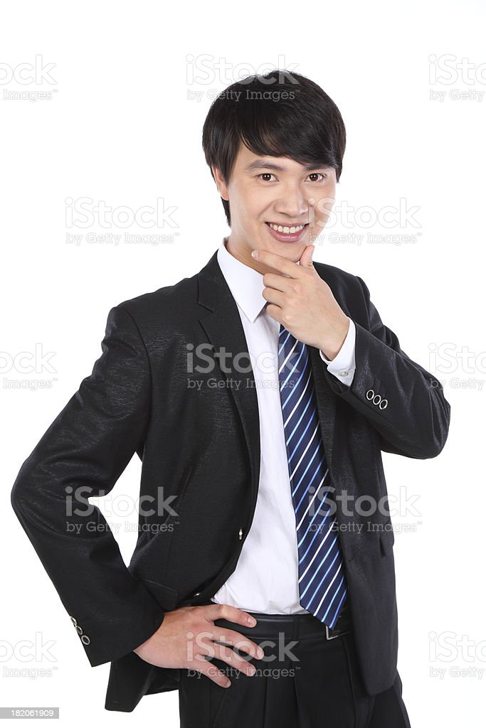 Frontal view of young Asian business man on white background royalty-free stock photo