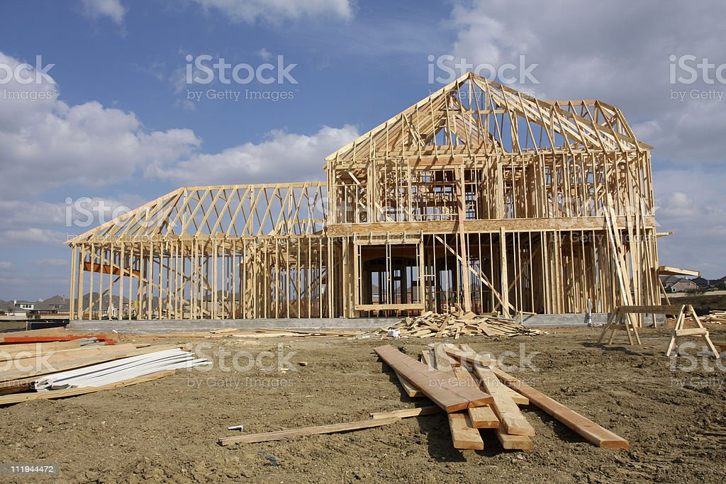 Frontal view showing construction of a new home being built royalty-free stock photo