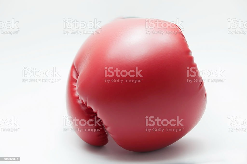 Front-faced boxing glove in white isolated background stock photo