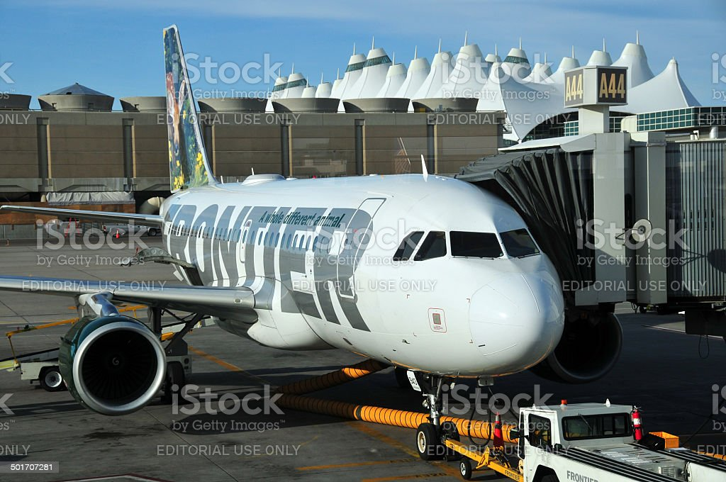Frontier Airlines aircraft at Denver International Airport stock photo