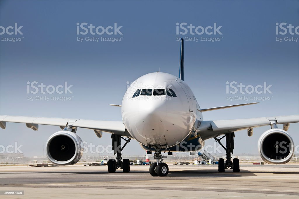 Front-view of airplane on runway stock photo