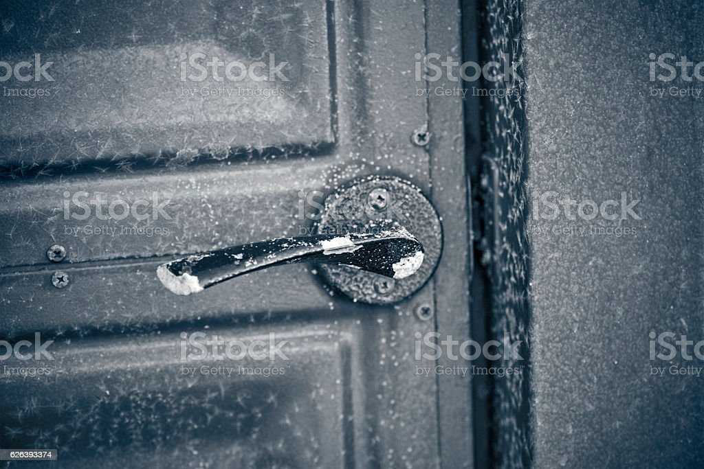 Frost door handle on the gate stock photo