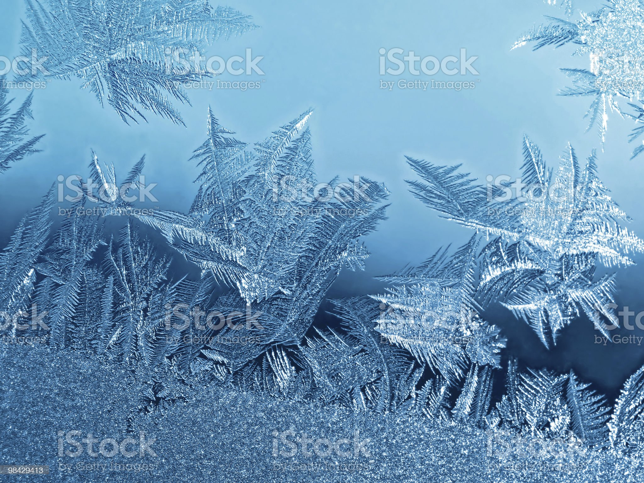 Frost icy flowers on a glass royalty-free stock photo
