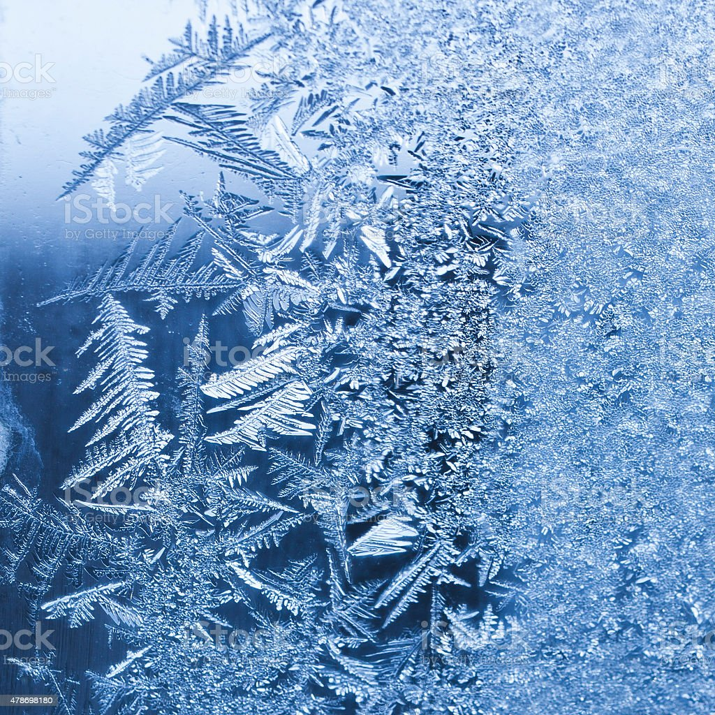 Frost on a window on a cold winter morning stock photo