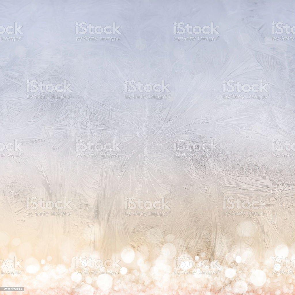 Frost patterns on window. Festive bokeh background stock photo
