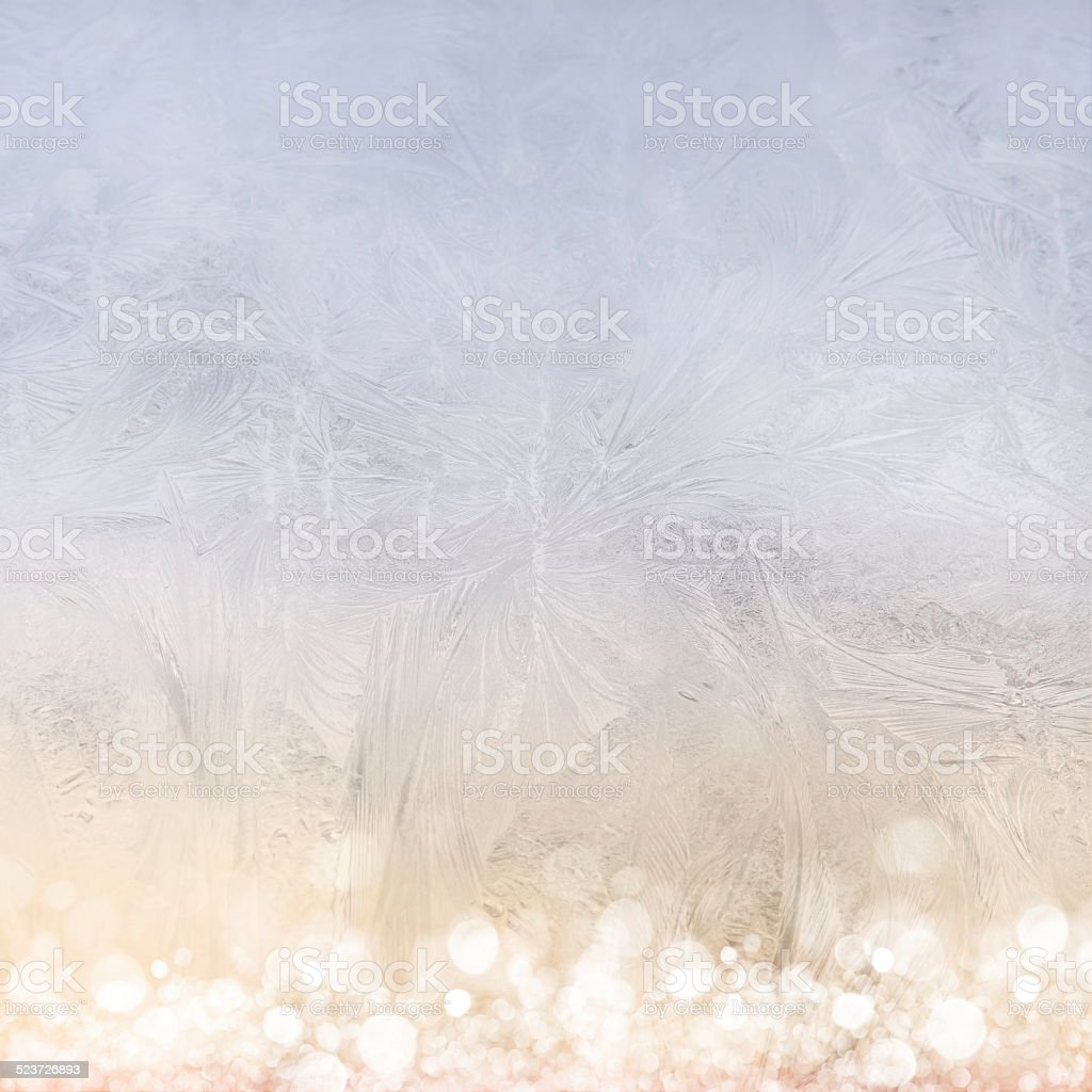 Frost patterns on window. Festive bokeh background stock photo