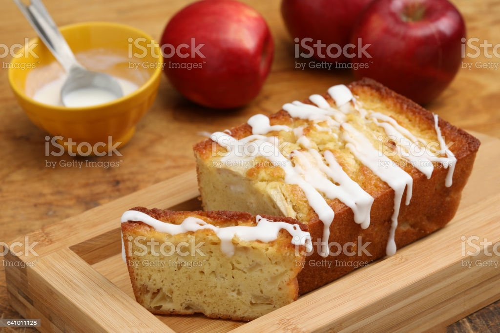 Frosted Buttermilk Red Apple Loaf And Some Red Apples stock photo