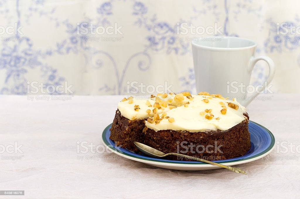 Frosted carrot and walnut cake. stock photo