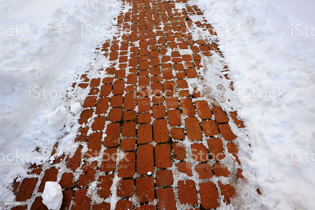 Frosted Red Bricked Sidewalk In Winter stock photo