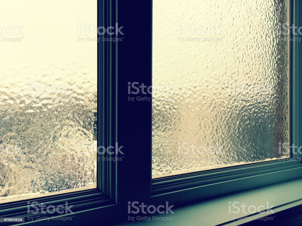 Frosted window pane in winter stock photo