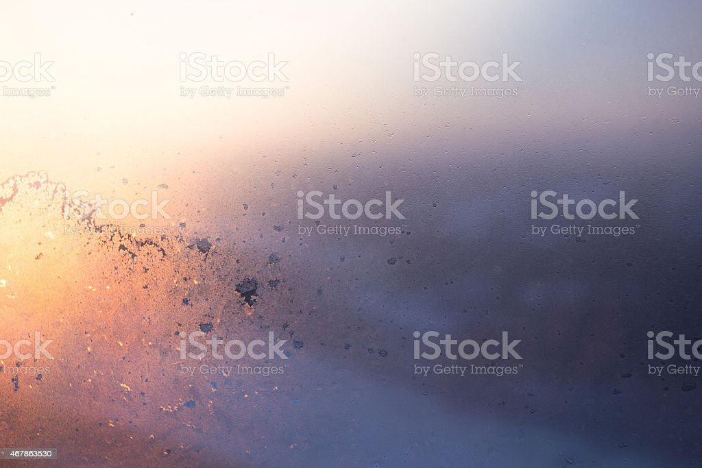 Frosted window sunrise stock photo