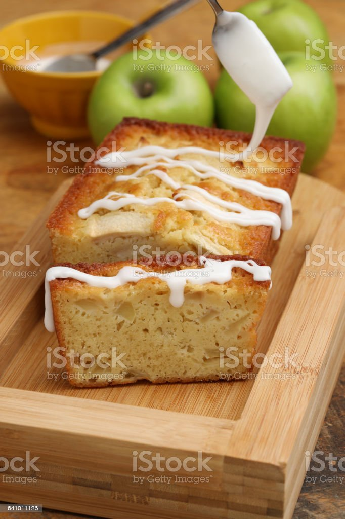Frosting A Butter Milk Apple Loaf stock photo