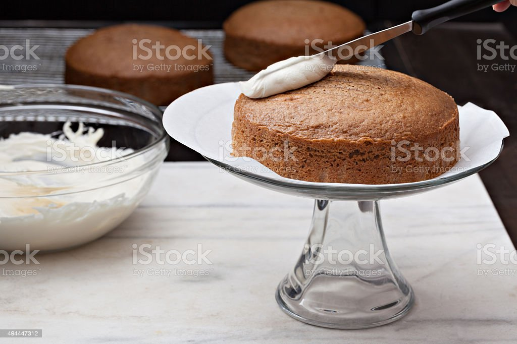 Frosting A Spice Cake stock photo