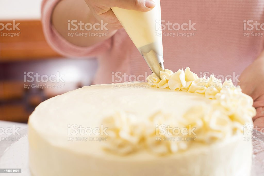Frosting the cake stock photo