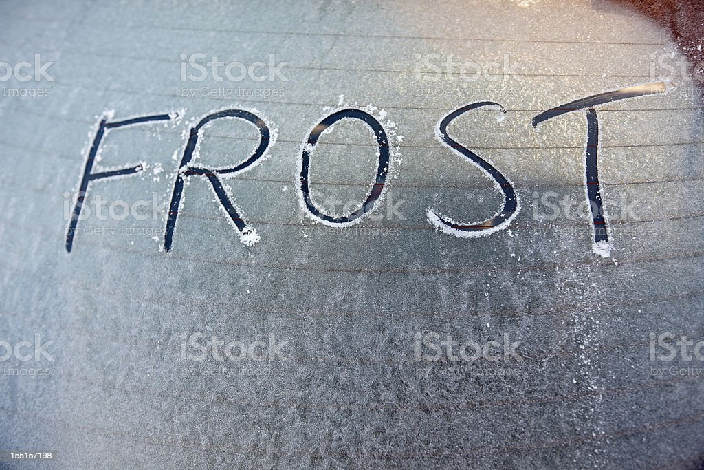 Frosty car window with word frost written on it stock photo
