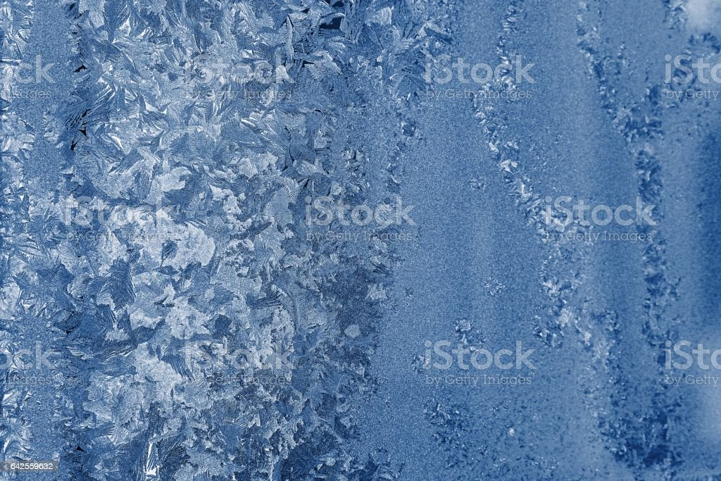 frosty glass with a silvery blue pattern stock photo