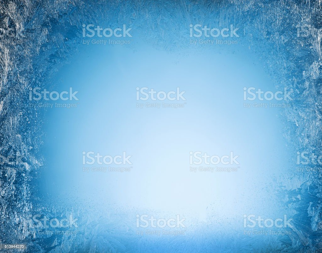 Frosty on the edge of a frozen window. stock photo