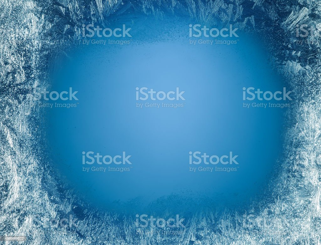 Frosty patterns on the edge of a frozen window. stock photo