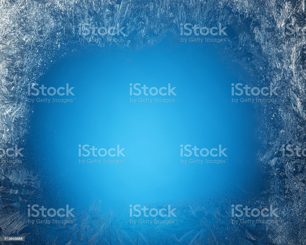 Frosty patterns on the edge of window. stock photo