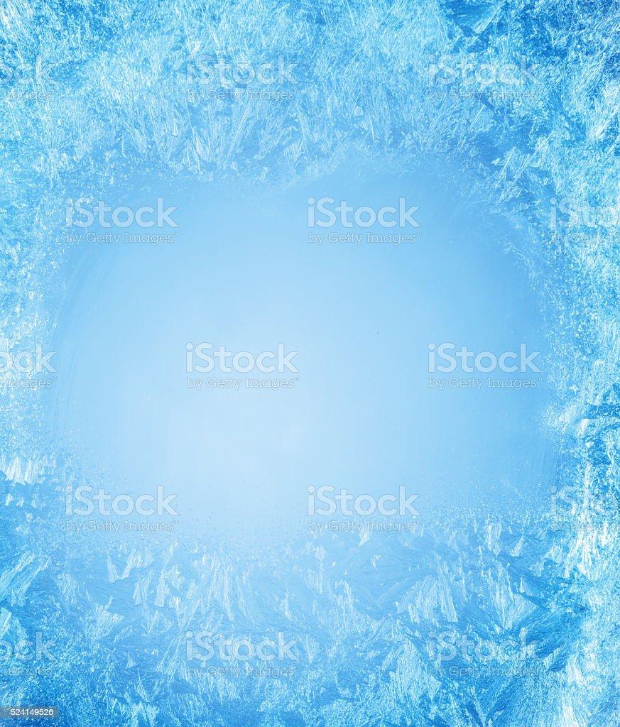 Frosty patterns on the frozen window. stock photo