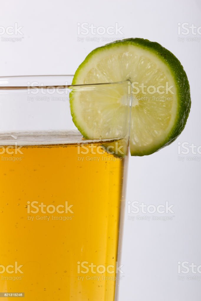 Frosty Pint Glass of Beer with Lime on the Rim stock photo