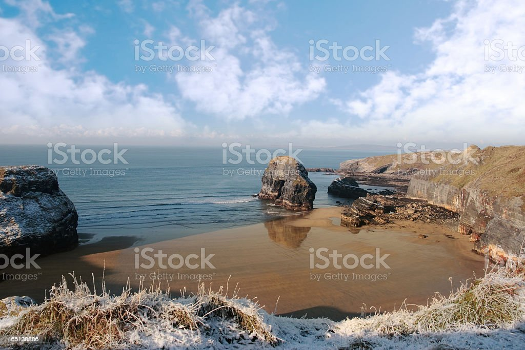frosty snowcovered coast beach and virgin rock stock photo