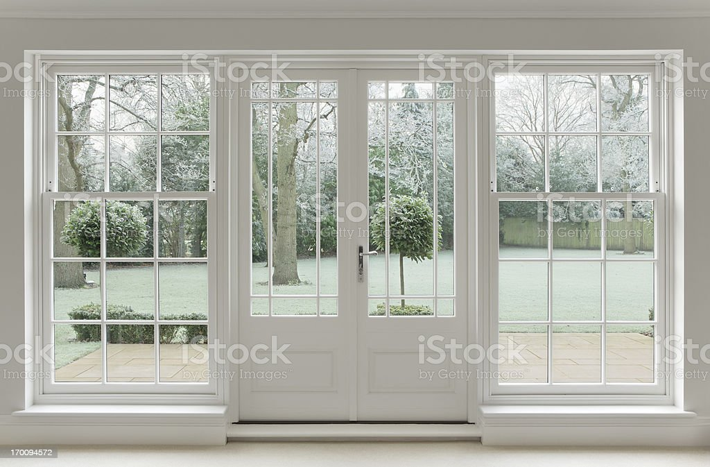 frosty view through white windows stock photo