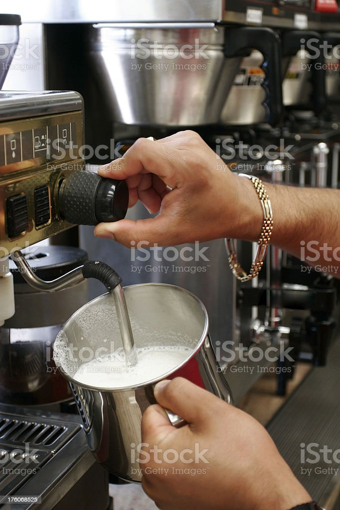 Frothing Milk at a Cafe with Steam stock photo