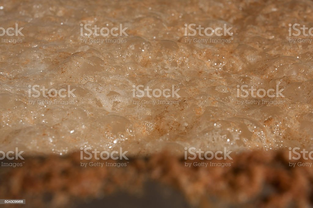Frothy beer mash in a brewery stock photo