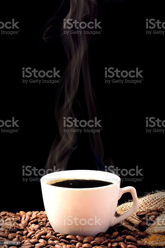 Frothy coffee cup with beans in the corner fabric flax stock photo