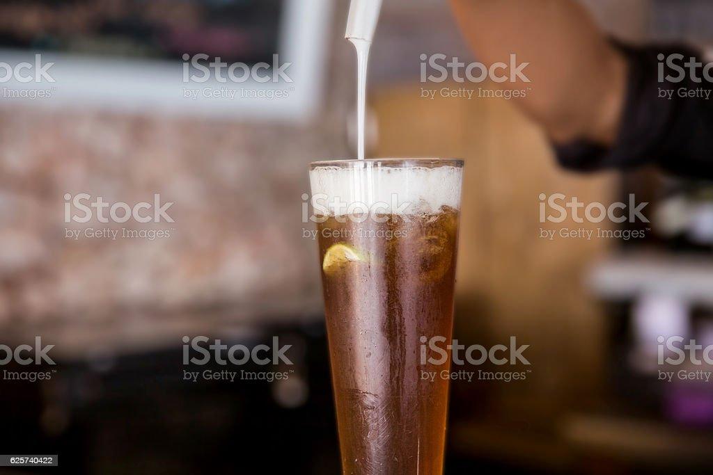 Frothy iced tea stock photo